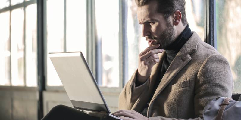 man-wearing-brown-jacket-and-using-grey-laptop-874242.jpg