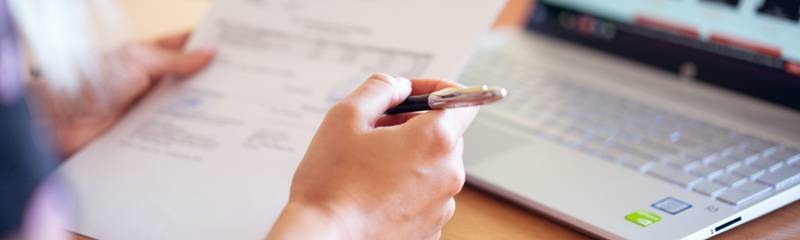 person-holding-pen-and-paper-2646033.jpg